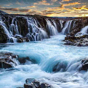 Bruarfoss waterfall by Páll Jökull Pétursson - Landscapes Waterscapes ( orange, iceland, 2014, blue, sunset, waterfall, canon eos 5d mkii, night, flow, rocks, longexposure, river )