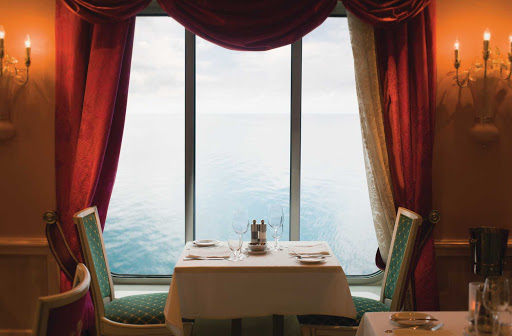Norwegian-Pearl-Dining-Palace-1 - Sit with your date by the window of Norwegian Pearl's Summer Palace restaurant for perfect ocean views while enjoying your meal.