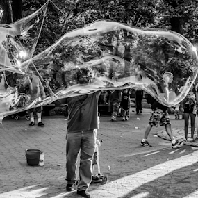 Bubbles in Central Park by Gina Gomez - Black & White Street & Candid ( urban picture, bubbles in central park, urban photo, photos of new york city street, city streets, new york city streets, street, manhattan, big bubbles in central park, street scene, nyc, city people, nyc street, city landscape, urban jungle, urban, urban scene, big apple, big bubbles, blowing bubbles, new york city, new york street )