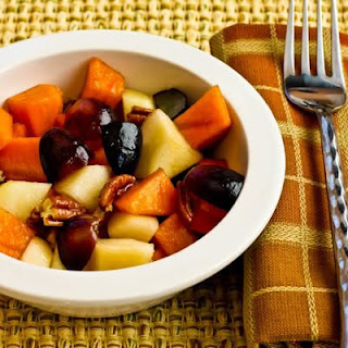 Winter Fruit Salad with Persimmons, Pears, Grapes, Pecans, and Agave-Pomegranate Vinaigrette.