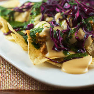 Nachos with Cabbage, Beans, and Cilantro Sauce.