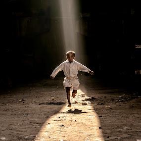 Dour by Shibasish Saha - Digital Art Things ( child, color, moment, street, candid, childhood, fun, light, shadows, spot light, jump,  )