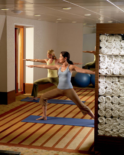 Spa-Fitness-Yoga-in-the-Fitness-Center - Try yoga to stretch and relax those muscles while enjoying a Crystal cruise.