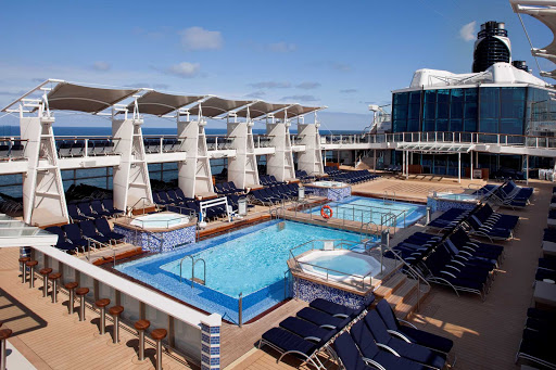 Celebrity_Eclipse_PoolDeck - Cool off in the crystal blue pools while you travel on Celebrity Eclipse.