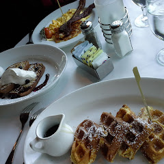 waffles, french toast, hashbrowns eggs and bacon