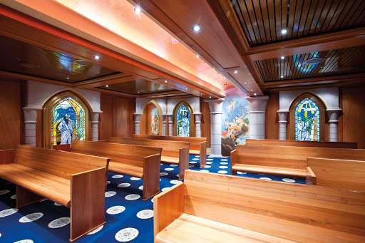 Carnival-Legend-Chapel - Planning a romantic cruise honeymoon? You can also exchange vows at sea in Carnival Legend's lovely wedding chapel.