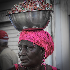 Woman vendor, St Martin by Judith Dueck - People Portraits of Women ( face, headgear, suspicious, fashion, arts, clothing, street, candies, covering, mardi gras, people, spectacle, caribbean, parade, watching, woman, event, festival, pink, head, customs, black, profile, selling, carnival, vendor, scared, display, st martin, earing, mardi, visual, afraid, headdress, public, fear )