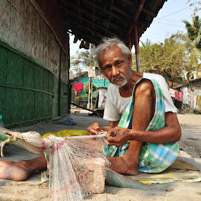 fish net by Subrata Chatterjee - People Portraits of Men