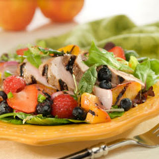 Grilled Pork With Spicy Peach & Berry Vinaigrette Salad.