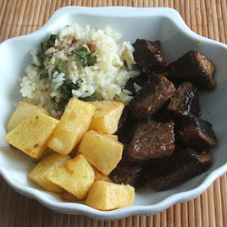 Veal Cubes With Coriander Rice And Fried Potatoes.