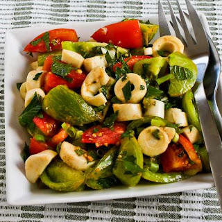 Colorful Tomato Salad with Hearts of Palm, Mint, and Spicy Thai Dressing.