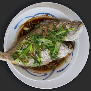 Steamed whole snapper with Soy, Ginger and Spring Onions.