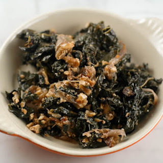 Braised Kale with Caramelized Onions, Walnuts, and Blue Cheese.