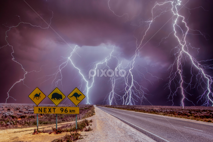 Highway massacre by Craig Eccles - Landscapes Weather ( thunder, sign, lightning storm, lightning, desert, highway, cloud, thunderstorm., thunder storm, road, storms, storm,  )