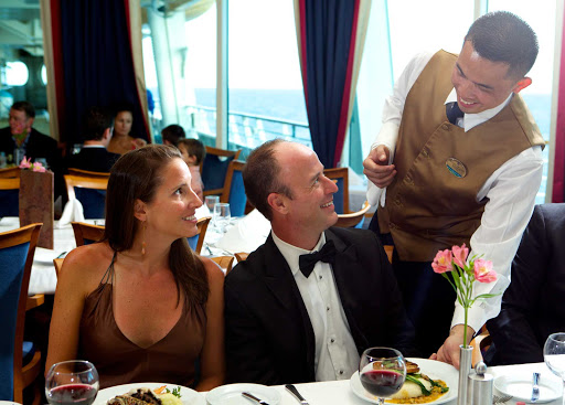 Freedom-of-the-Seas-dining-room - Enjoy sumptuous ocean views while dining during your sailing to the Caribbean aboard Freedom of the Seas.