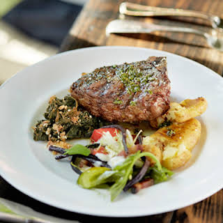 Grilled Bone-In Bison Steaks with Crisped Potatoes.