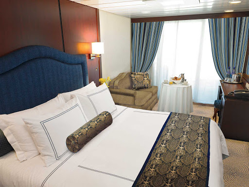 Oceania-B-Veranda-Stateroom-2 - Oceania Insignia's Veranda stateroom offers a private teak veranda for taking in panoramic views, a queen bed with 1,000-thread-count linens, a vanity desk, refrigerated mini-bar, breakfast table and spacious seating area. It's located mid-ship on deck 6 and is 216 square feet.