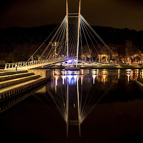 Ypsilon Bridge By Night by Lillian Molstad Andresen - Buildings & Architecture Bridges & Suspended Structures ( water, drammen city, hill, streetlight, silhouette, reflections, city, norway, stairs, drammen, ypsilon bridge, trees, night, ypsilon, bridge, light, river, , Lighting, moods, mood lighting, Urban, City, Lifestyle )