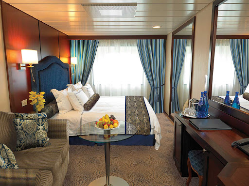 The C Level Deluxe Ocean View staterooms on Oceania Nautica contain custom-designed furnishings, queen or two twin bed accommodations, spacious seating area, vanity desk and breakfast table. At 165 square feet, they're located on decks 4,6 and 7.