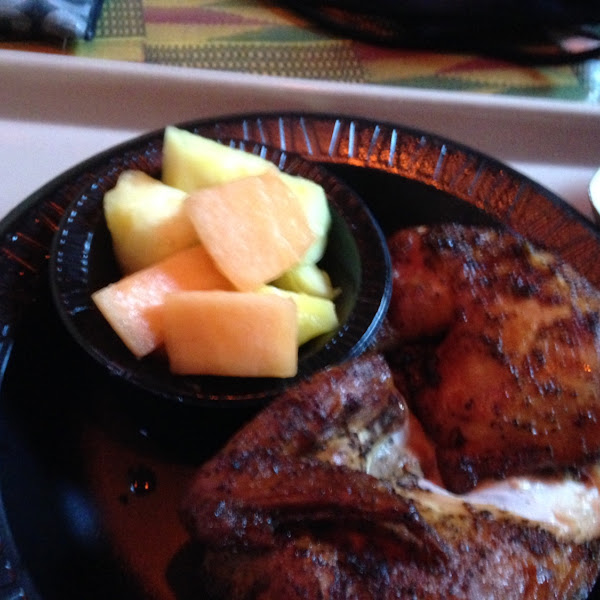 Gluten free chicken, fruit, corn on the Cobb, and salad at Zambia smokehouse