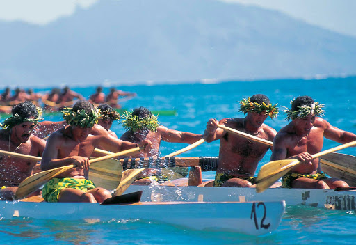 "Outrigger-Canoe-Racing-Tahiti - Tahitian outrigger races feature paddlers dressed in colorful pareos and traditional ""heis"" and leis for races and demonstrations."