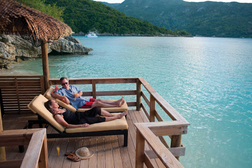 Getaways done right: A couple watches the water action from a cabana in Labadee, Royal Caribbean's 260-acre private beach resort on the north shore of Haiti.