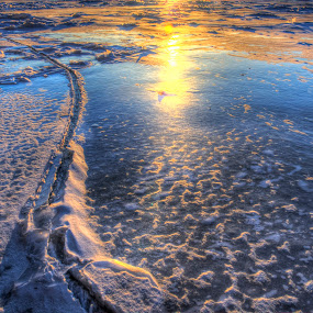 Sunset over a Crusted Lake Superior by Marilyn Magnuson - Landscapes Sunsets & Sunrises ( snow and ice, sunset over ice, ice, crack in ice, lake superior )