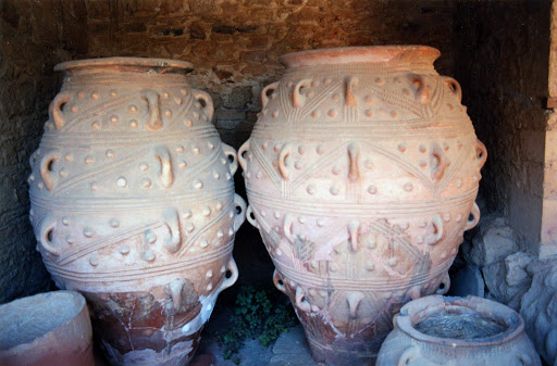 pithoi-at-Palace-of-Knossos - Six-foot-tall pithoi, or storage jars, at the Palace of Knossos. The jars, dating from the 18th century B.C., were used to store honey, wine and food.