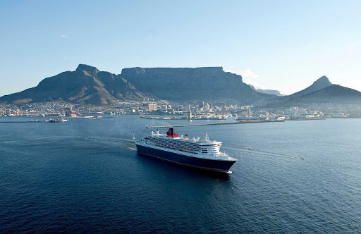 Cunard-Queen-Mary-2-in-Cape-Town - Take in sweeping views of the mountains and landscape of Cape Town, South Africa, during a sailing aboard Queen Mary 2.