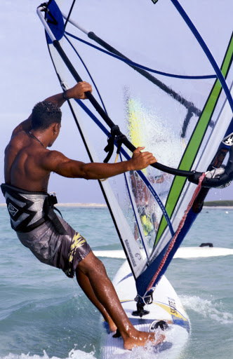 Bonaire-windsurf - A windsurfer does his thing in the waters off Bonaire.