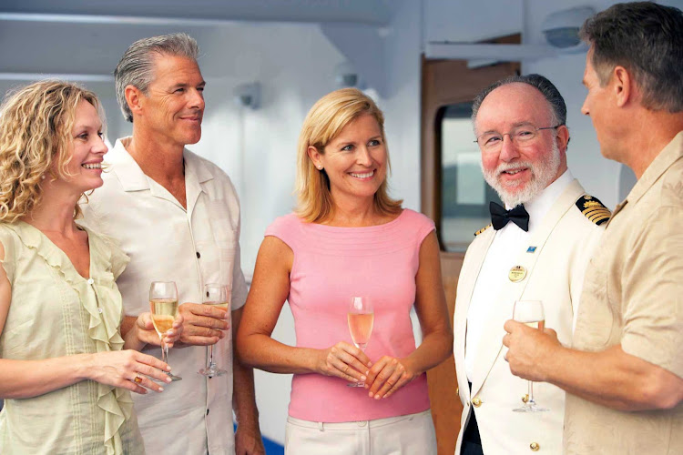 The ship's captain and crew frequenty interact with guests during a Princess cruise.