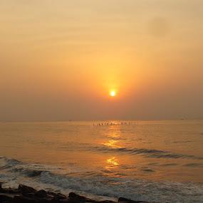 Sunrise by Chirag Gupta - Landscapes Sunsets & Sunrises ( orange, dawn, sea, beach, sunrise, yellow, sunlight, morning, sun )