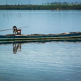 Lonely Sail by Ryan Lemil Escarpe - Transportation Boats ( bangka, fish boat, cebu, sea, solitude, boat, philippines )