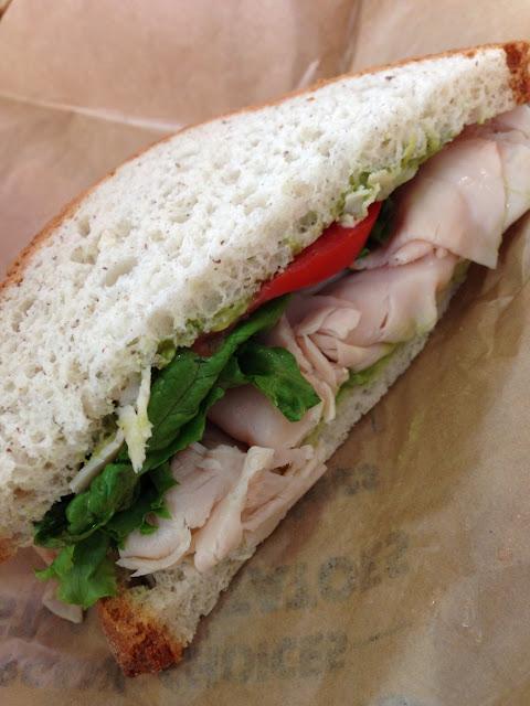 Half sandwich with turkey and guacamole on Udi's bread