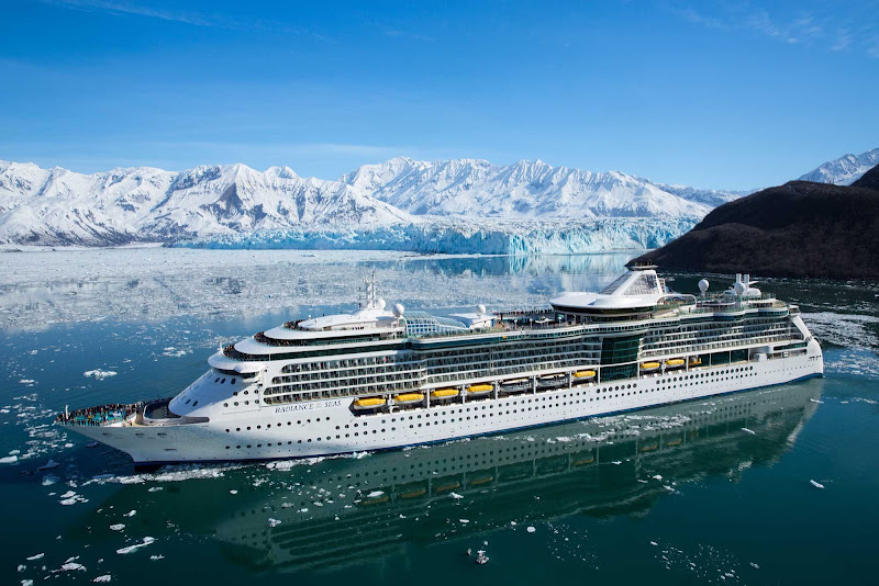 Radiance of the Seas sails through a strait hugged by glaciers in Alaska, giving passengers astonishing views of the snow-topped mountains along the coast.