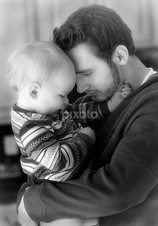 A Candid Moment by M Knight - People Family ( enthusiasm, connection, dad with kids, passionate, moods, black and white, son, candid, dad and kid, people, improving mood, father, child, love, red, family, passion, the mood factory, man, inspirational )
