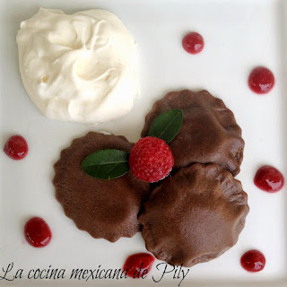 Chocolate Ravioli Filled with Raspberry Cream.