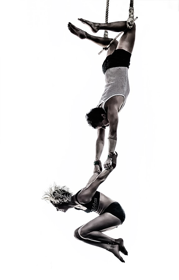 Acrobats by Jim Merchant - People Musicians & Entertainers ( high key, acrobats, daring, couple )