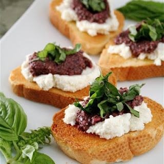 Bruschetta with Black Olive Pesto, Ricotta, and Basil