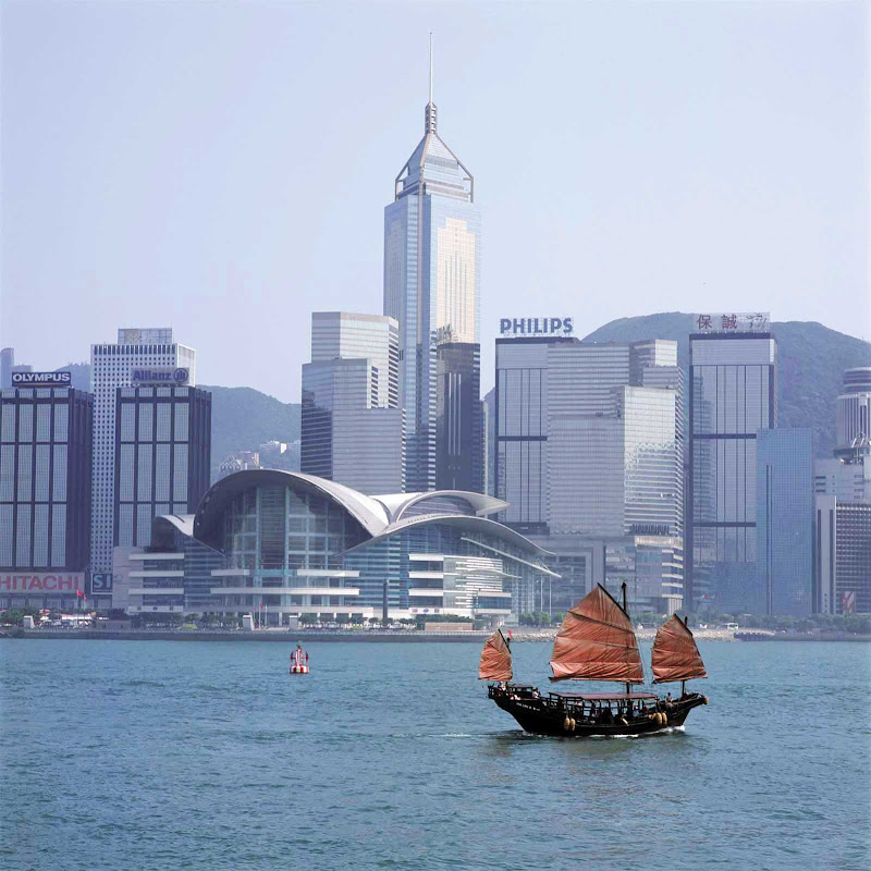 A junk sails in Victoria Bay, Hong Kong.