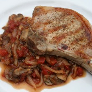 Grilled Pork Chops with Chunky Mushroom-Tomato Sauce.
