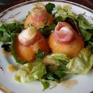 Melon, Prosciutto, and Mozzarella Appetizer with a Mint Melon Dressing.