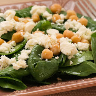 Spinach Salad with Marinated Garbanzo Beans and Feta Cheese.