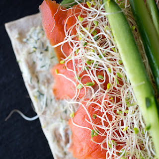 Smoked Salmon Lavash Wrap with Spicy Greens, Fresh Cucumber and Sprouts with Savory Lemon-Dill Cream Cheese Spread.