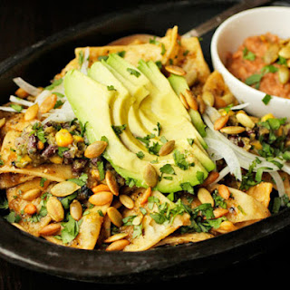 Chilaquiles With Pepitas, Charred Corn, and Black Beans
