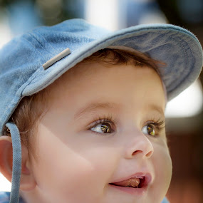 Camera shy by Laura Prieto - Babies & Children Babies ( baby with cap, blue, baby smile, baby big eyes, baby model axel, baby boy )