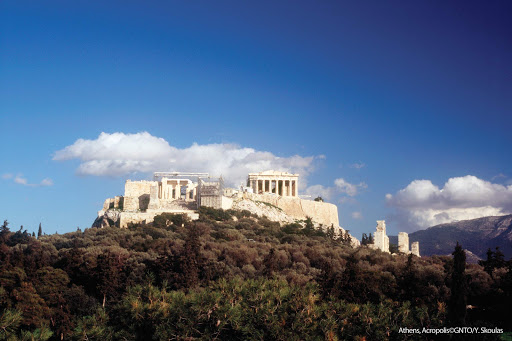 View of the iconic Acropolis set atop a hilltop in Athens, Greece.