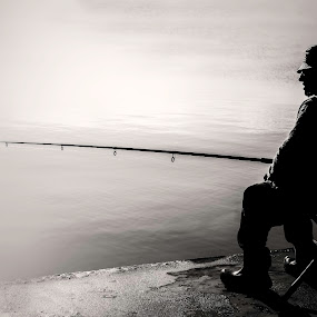 Fiherman by Paulo Veiga - People Street & Candids ( calm, water, b&w, 2014, black and white, silhouette, paulo veiga, hobby, pixoto, bw, avocation, salt water, photography, chair, resting, pastime, peace, fiherman, oldman, fishing, rest,  )