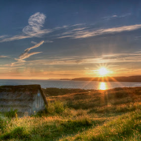 Seaweed drying hut by Brian Miller - Landscapes Beaches ( wales, hut, sunset, beach, coast )