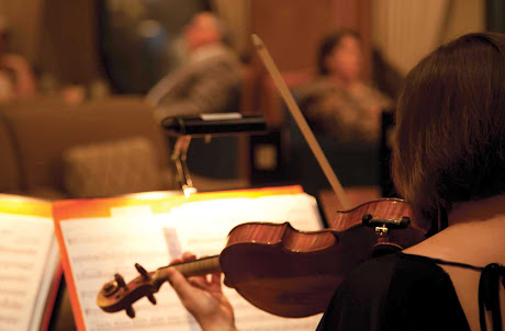 You'll appreciate the beautiful strains of classical music played by a live orchestra aboard Queen Mary 2.
